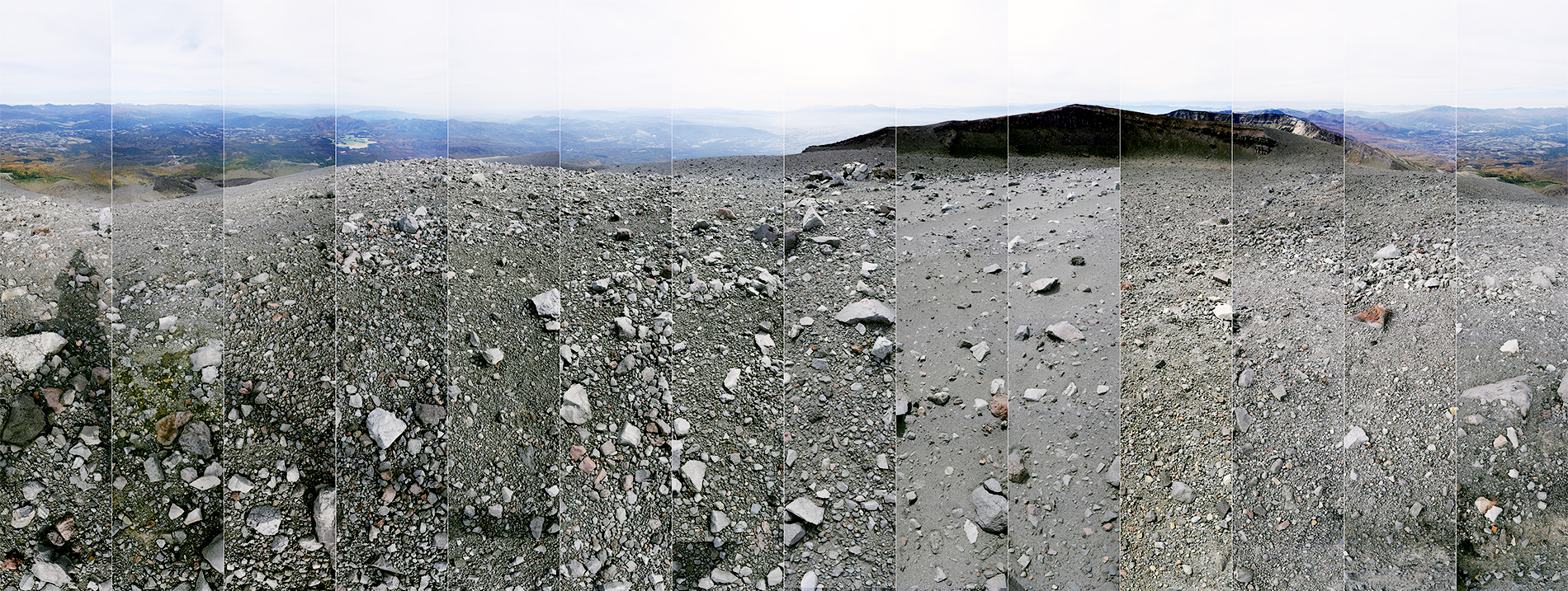 Mount Asama - Crater Edge- 21-10-2016 by - Wouter van Buuren - Mount Asama in Japan is a Volcano on the border of the Nagano and Gunma prefectures. Here we see the landscape from the inner crater edge, volcanic rocks, stones and dust. Also we see the shadow of the artist Wouter van Buuren while photographing from North to East to South to West and back to North. Far on the South horizon there is a glimps of Mount Fuji.