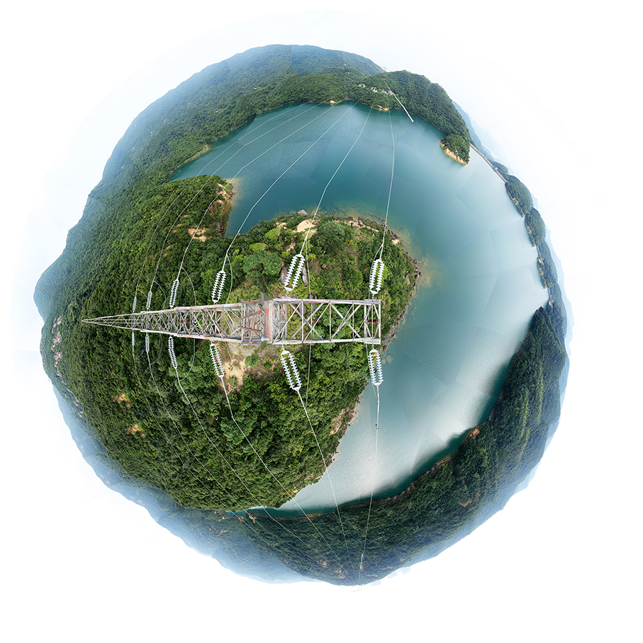 Tai Tam Reservoir lake - Hong Kong Island - 360 degree landscape photographed from the summit of a transmission tower.  The circular image represents the self in a holisitic cosmos. The perspective is a result of a view obtained after climbing electricity tower. The collage of photographs forms a circle.
